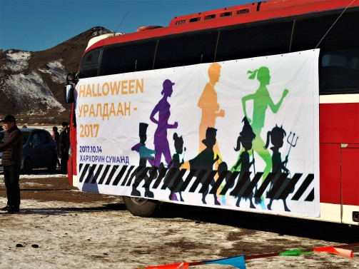 The Halloween Race banner that was hung on the side of the bus.